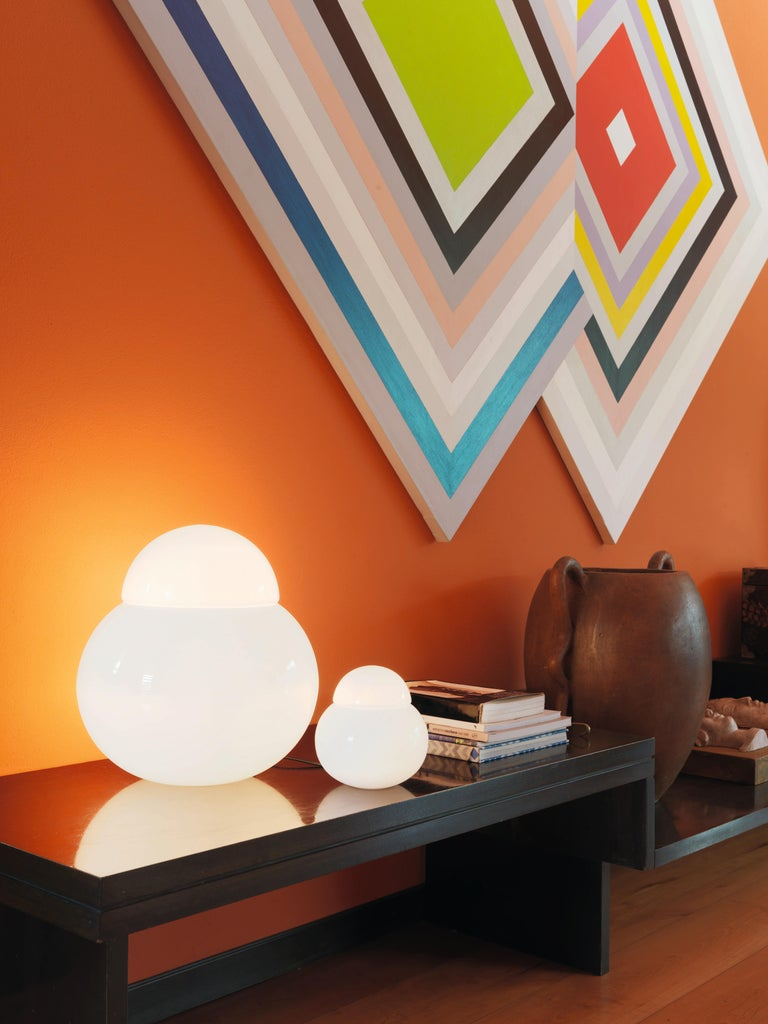 Large Sergio Asti 'Daruma' table lamp for Fontana Arte. Designed in 1968 by Sergio Asti, this Minimalist yet highly refined table lamp is comprised of two geometric opaline glass diffuser elements in a play on Japanese Daruma dolls. The resulting