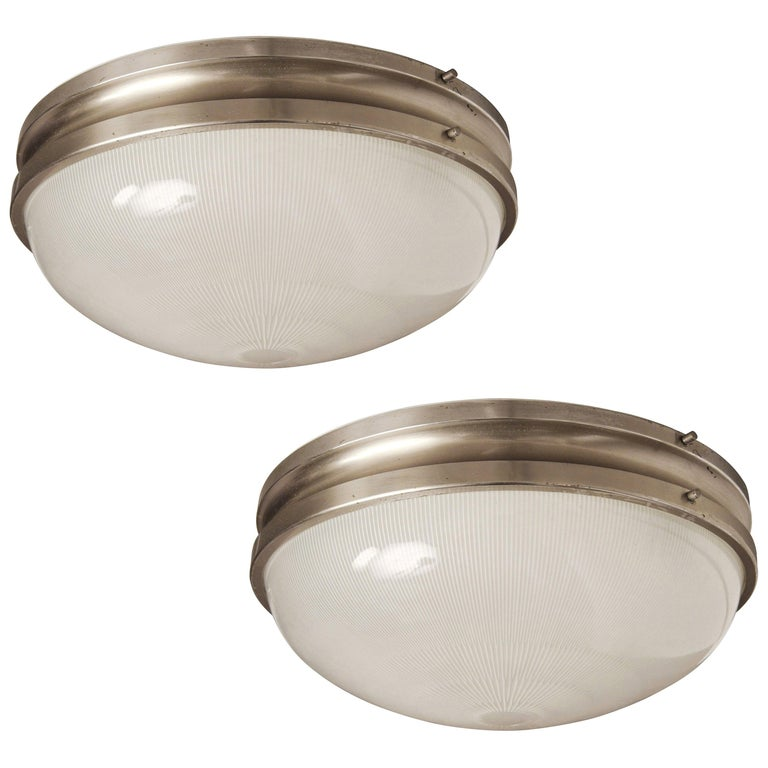 Large Sergio Mazza 'Sigma' wall or ceiling lights for Artemide, 1960s. Executed in nickeled brass and pressed Opaline glass by Sergio Mazza for Artemide, Italy, circa 1960s. Each light has been professionally rewired for US electrical and
