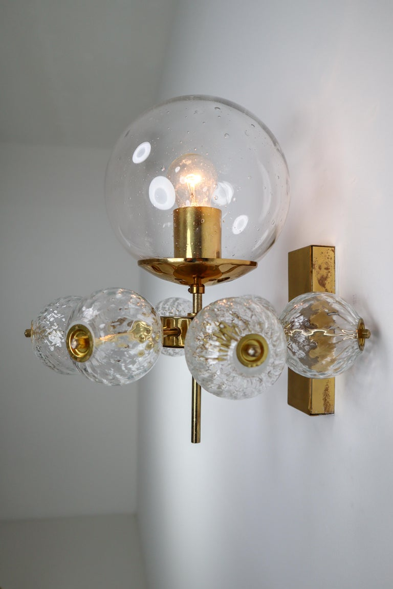 Large set of 20 hotel wall chandeliers with brass fixture and large hand blown glass. The scones are beautifully decorated thanks to the structured glass. The pleasant light it spreads is very atmospheric, these wall chandeliers will contribute to a