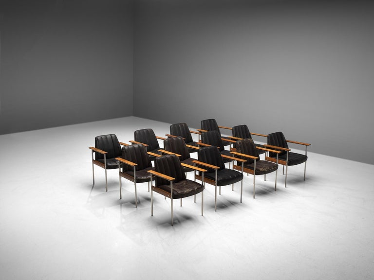 Sven Ivar Dysthe for Dokke Møbler, combined set of 24 dining chairs, black leather, steel, rosewood, Norway, circa 1959.  These well-crafted office chairs are designed by Sven Ivar Dysthe. The base of these office chairs is made of rosewood with