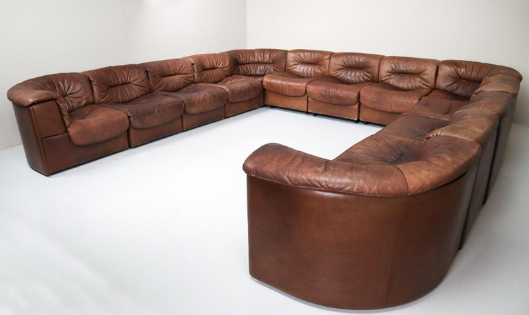 Large set of 19elements patinated leather De Sede DS 14 modular sofa, 1970. This comfortable leather sofa is manufactured by De Sede in Switzerland. Sectional sofa by the Swiss quality manufacturer De Sede. This large sofa exists of 19 elements, 6