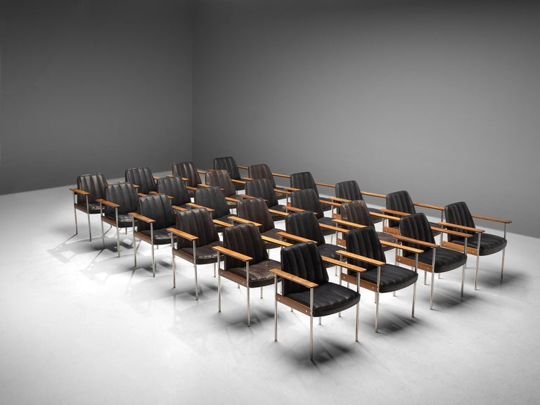 Sven Ivar Dysthe for Dokke Møbler, combined set of 24 dining chairs, black leather, steel, rosewood, Norway, circa 1959.  These well crafted office chairs are designed by Sven Ivar Dysthe. The base of these office chairs is made of rosewood with