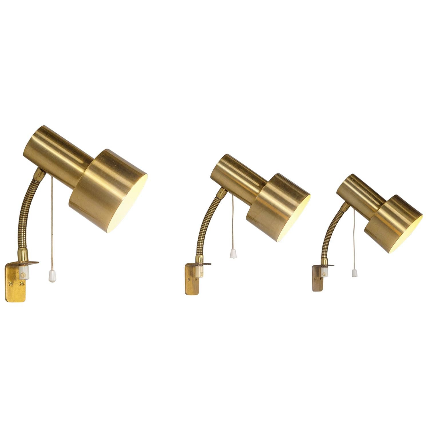 Large Set of Adjustable Brass Wall Lights