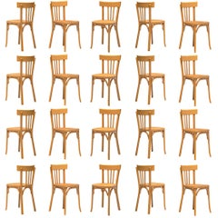 Large Set of Baumann Dining Chairs , 100 +, in Beechwood, France, 1970s