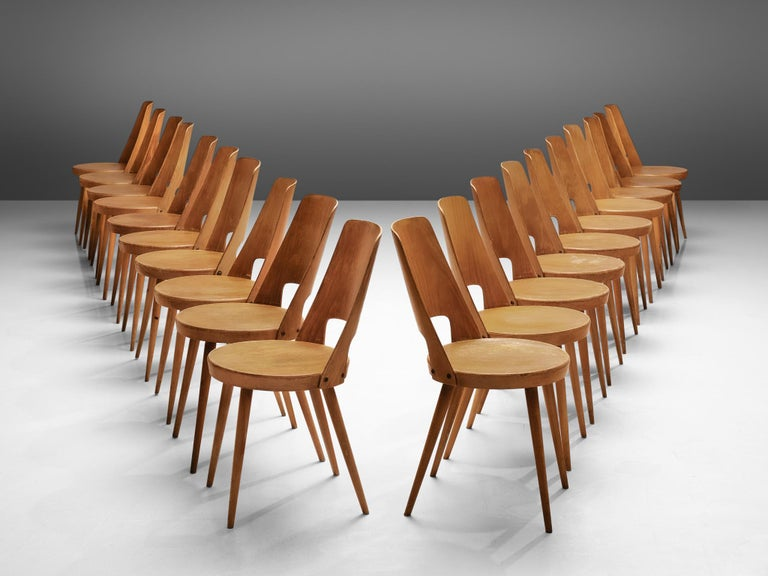 Baumann, large set of 75 'Mondor' dining chairs, beech wood, France, 1960s  This large set of Baumann chairs, model 'Mondor', are a classic french bistro chair. The chair features a solid construction with a bentwood backrest. The legs are tapered