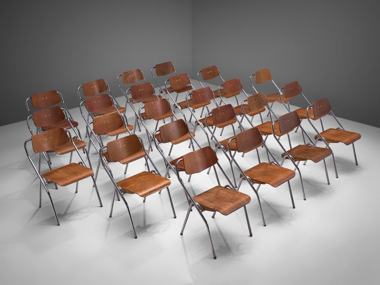 Large set of + 200 chairs, metal and plywood, the Netherlands, circa 1930s  This very large set of midcentury, Dutch school chairs would be a great choice for your project if you are looking for chairs that are easy to store. The seats are foldable