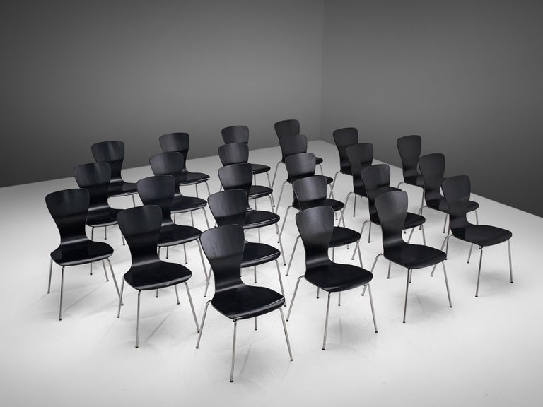 Tapio Wirkkala, dining chairs, black lacquered plywood and metal, Finland, 1950s.  Beautiful set of 'Nikke' chairs design by the Finnish designer Tapio Wirkkala. This model is a wonderful example of early minimalist design. The chair consists of a