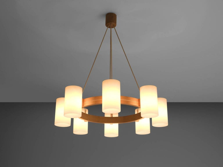 Chandeliers, oak and opaline white Lucite, Sweden, 1960s.  This is a large set of warm, soft and organic chandeliers by Luxus. These large sculptural wooden chandeliers with eight white spheres create a warm and soft environment. The wood is solid