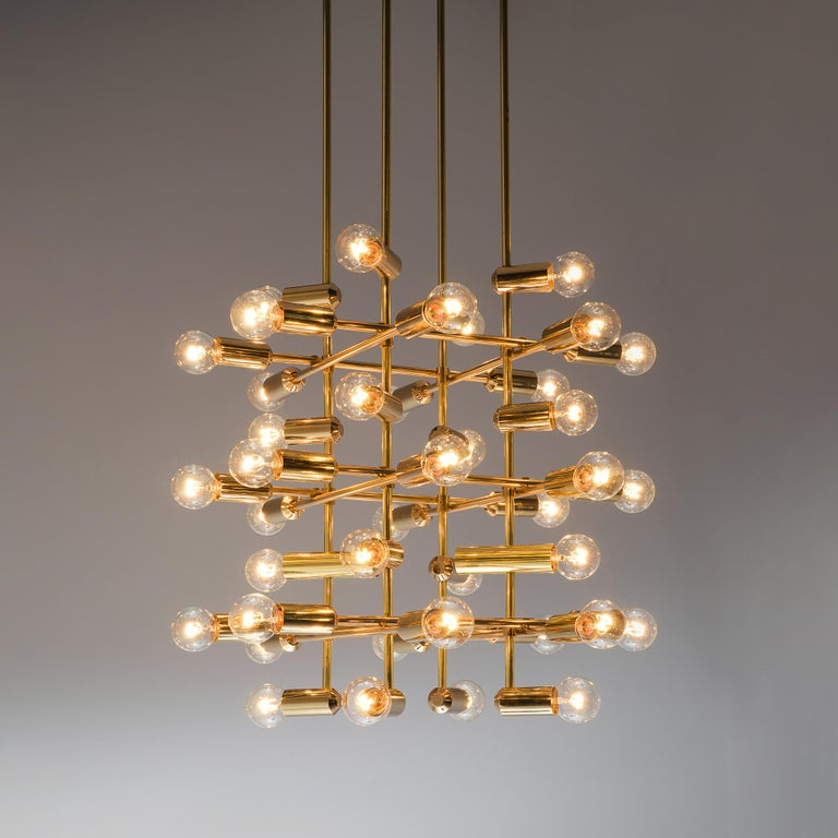 Mid-Century Modern Large Set of Swiss Chandeliers in Brass For Sale
