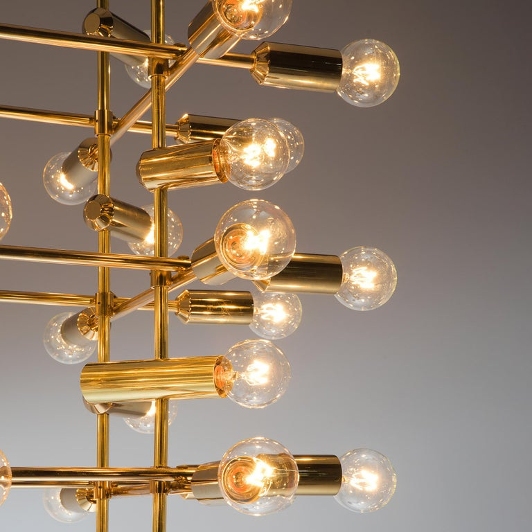 Mid-20th Century Large Set of Swiss Chandeliers in Brass For Sale