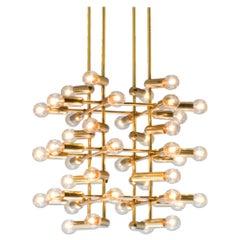 Large Set of Swiss Chandeliers in Brass