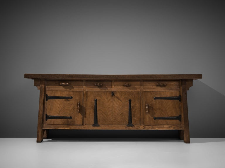 Ernesto Valabrega, large sideboard, oak, iron, Italy, ca. 1935  This large sideboard by Ernesto Valabrega features not only visual qualities but also great storage space. Four drawers and three doors are structuring the outside. The door in the