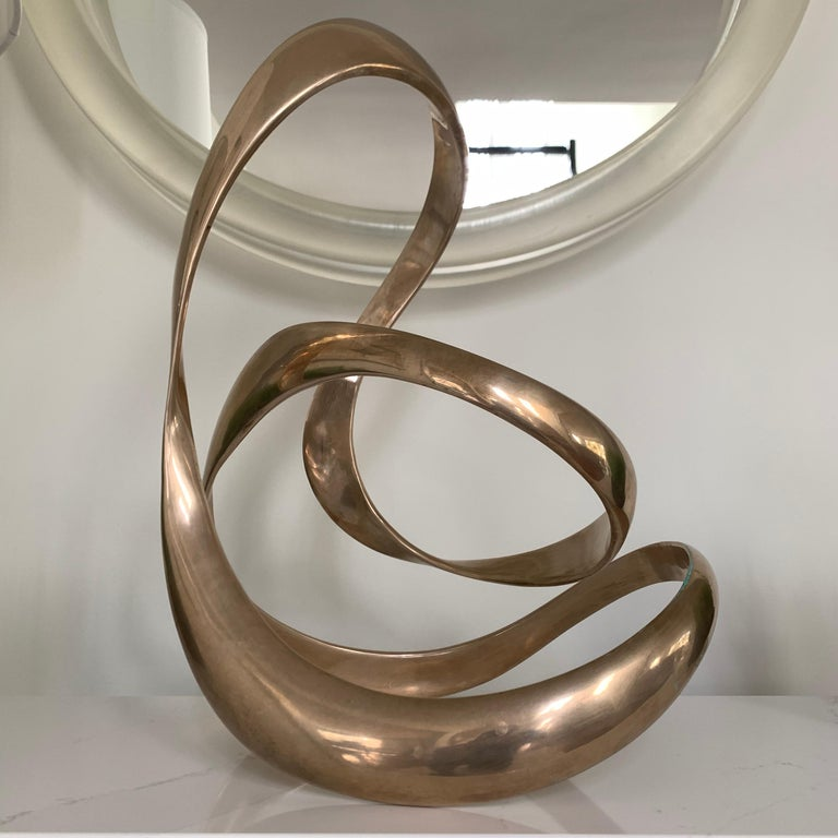 Large American abstract Kinetic sculpture, Tom Bennett. 47 of 100, dated 1988  Sculpture can be tipped to move forward and backwards  Bases can be sources at buyers request. Wood, marble, Lucite, acrylic or glass.