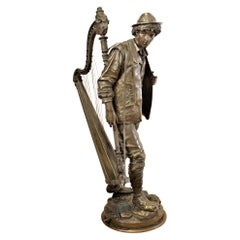 Large Signed Eutrope Bouret Bronze Sculpture of a Young Man Carrying a Harp