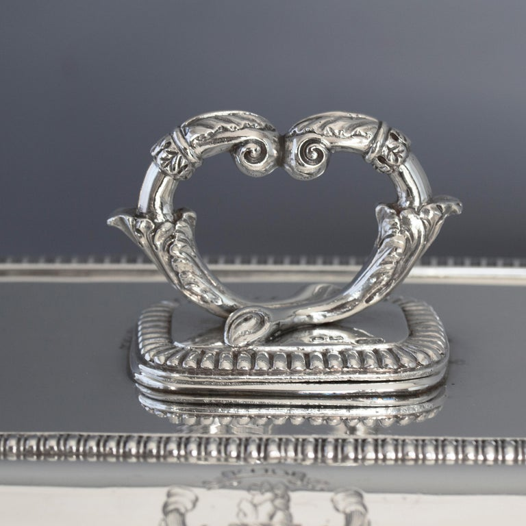 A superb good sized Georgian silver entree dish of rectangular cushion form. The top and edges with gadrooned decoration. The twist off handle with conforming decoration and heart shaped cornucopia. 