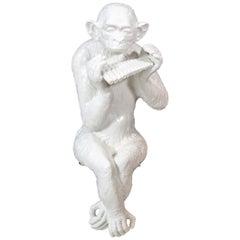 Large Sitting Chimpanzee Playing the Panpipes