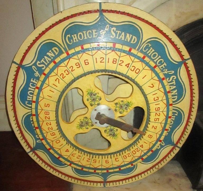 This large size double very colorful standing carnival wheel is an incredibly rare gaming device, and is a particularly special double-wheel model. The inner wheel uses a standard numeral gaming system, while the outer wheel gives the player a