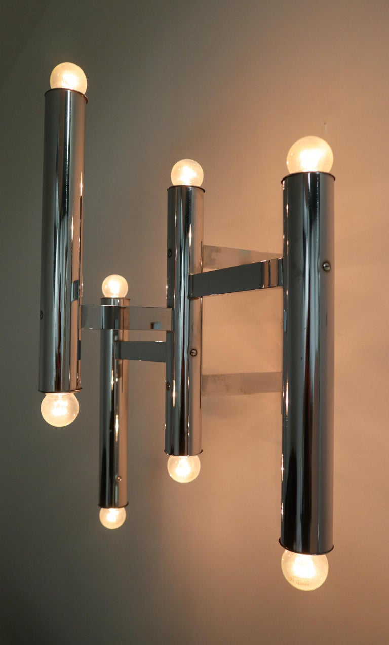 Large size midcentury chrome wall lights produced by Staff Leuchten, Germany, 1970s. The pleasant light it spreads is very atmospheric, these wall scones or fixtures will contribute to a luxurious character of the (hotel-bar) interior. Perfect