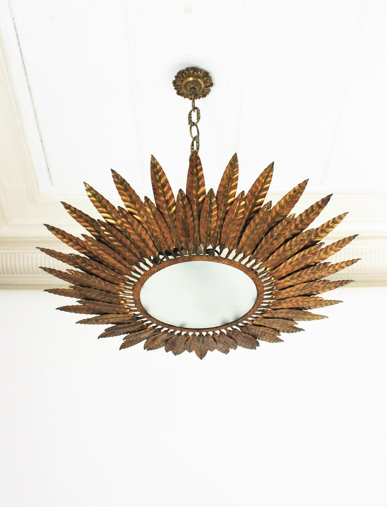 Large Spanish Sunburst Leafed Light Fixture in Gilt Metal with Frosted Glass For Sale 12