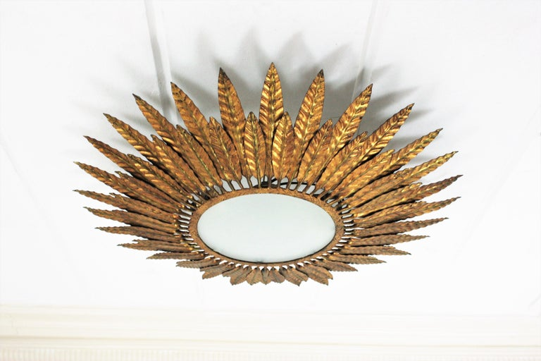 Mid-Century Modern Large Spanish Sunburst Leafed Light Fixture in Gilt Metal with Frosted Glass For Sale