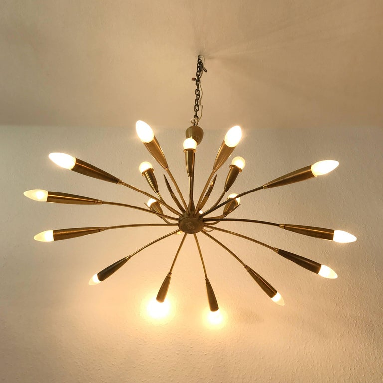 Large Sputnik chandelier with 18 arms. Manufactured in 1950s, Germany. The lamp needs 18 x E14 screw fit bulbs.