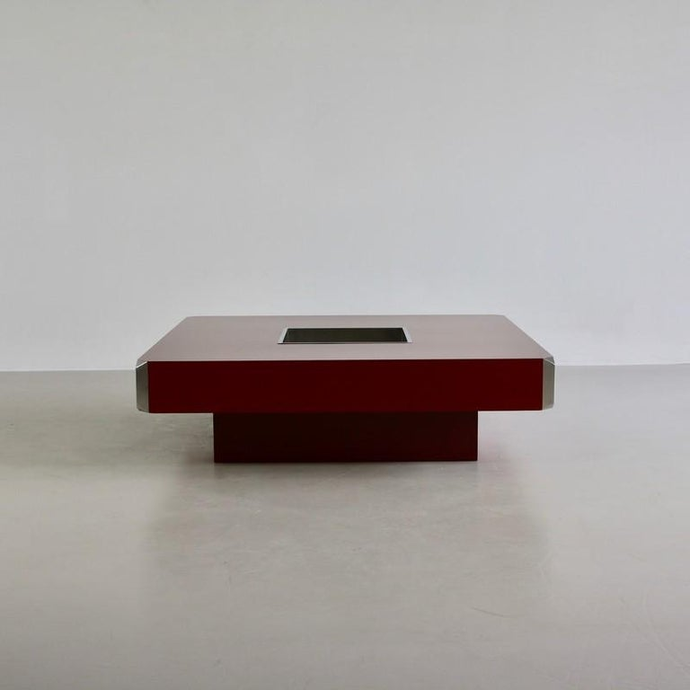 Square coffee table designed by Willy Rizzo, Italy, Mario Sabot, 1972.  Dark red coffee table with chrome-plated insert and chromed corner pieces. Rare in this color and wonderful condition.  Reference: Reference: Casa Vogue, no. 19, March 1973.