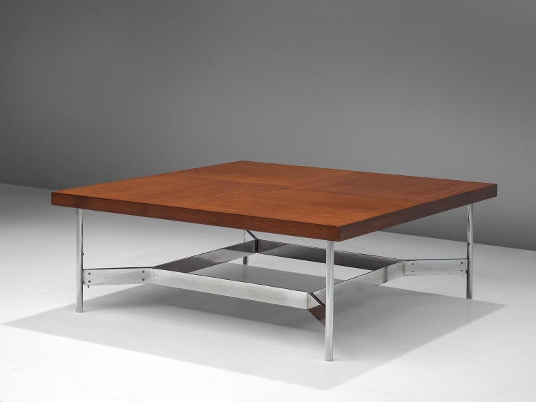 Coffee table, in teak and steel, Germany, 1960s.