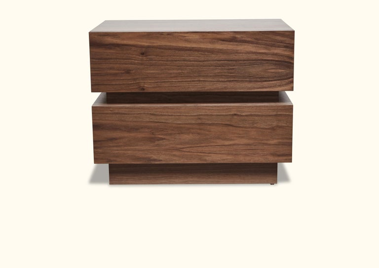 The stacked box nightstand is a bedside table with two drawers that is available in either American walnut or white oak. Available in two sizes.  Shown here in natural walnut.