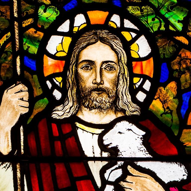 Stained glass window in very good condition, produced circa 1930. Reclaimed from a church in Fife, Scotland.   The window depicts Jesus with the words 'He leadeth me to the still waters' written on the scroll held above his head. by two