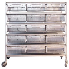 Large Stainless Steel Industrial Shelving with Wire Baskets on Casters