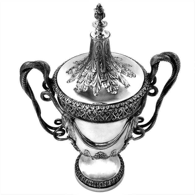 A magnificent solid Silver Cup with a monumental push fit lid. The Trophy is created in the Regency style with inspiration from the designs of Paul Storr. The Trophy has a pair of impressive handles each in the shape of two snakes twisted around