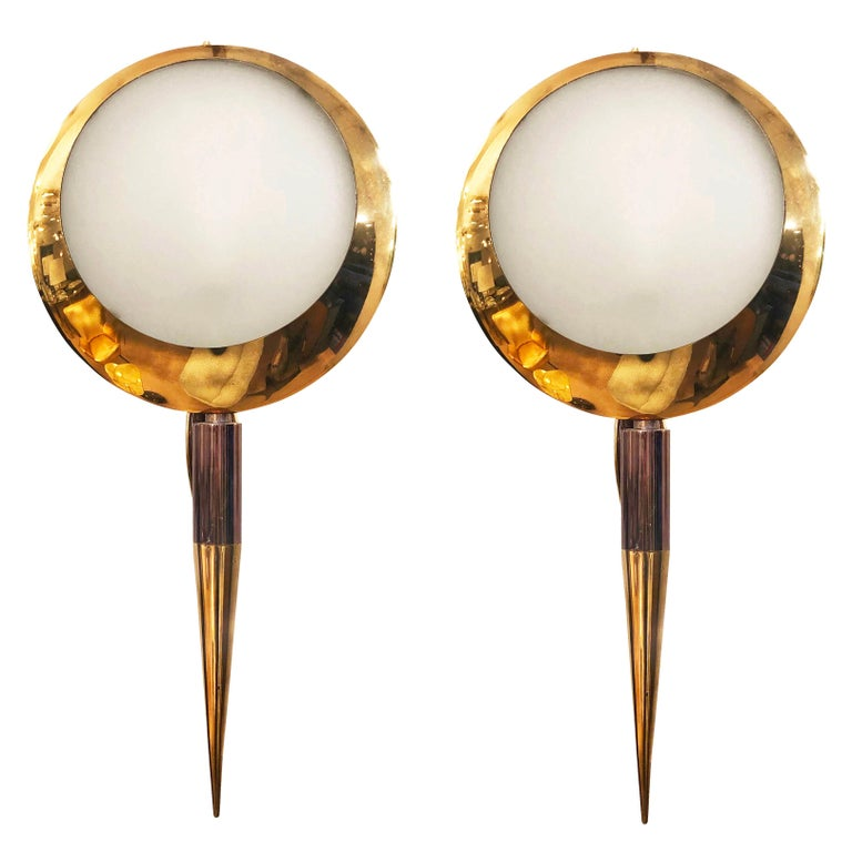 Spectacular wall lights by Stilnovo, model 2128, with the original stamped logo and label. The frame is mostly polished brass with some burnished accents. The outer glasses are detailed with a wonderful texture and frosted while the back glasses are