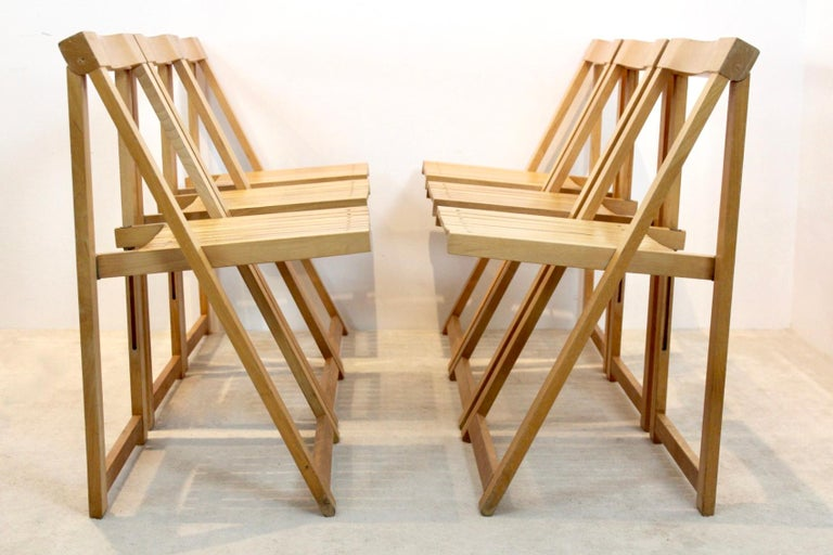 Comfortable folding chairs designed by Aldo Jacober for Alberto Bazzani. We have 40 pieces available. The chairs are made of Beechwood and have a very solid frame and a great sit. All in good condition with some user marks and beautiful patina