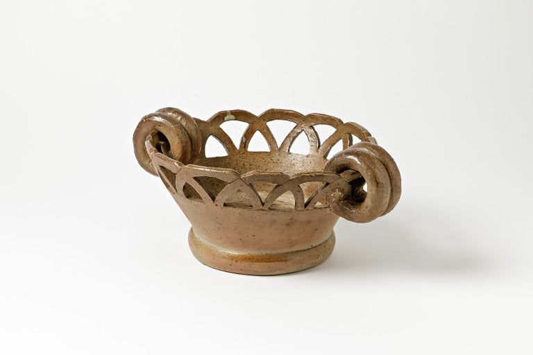 La Borne, circa 1950.  Attributed to François Guillaume after the second war.  Elegant stoneware ceramic cachepots with beautiful cut decoration.  Good condition, only traces of water inside. Easy to clean up.  Dimensions: 14 x 35 x 26 cm.