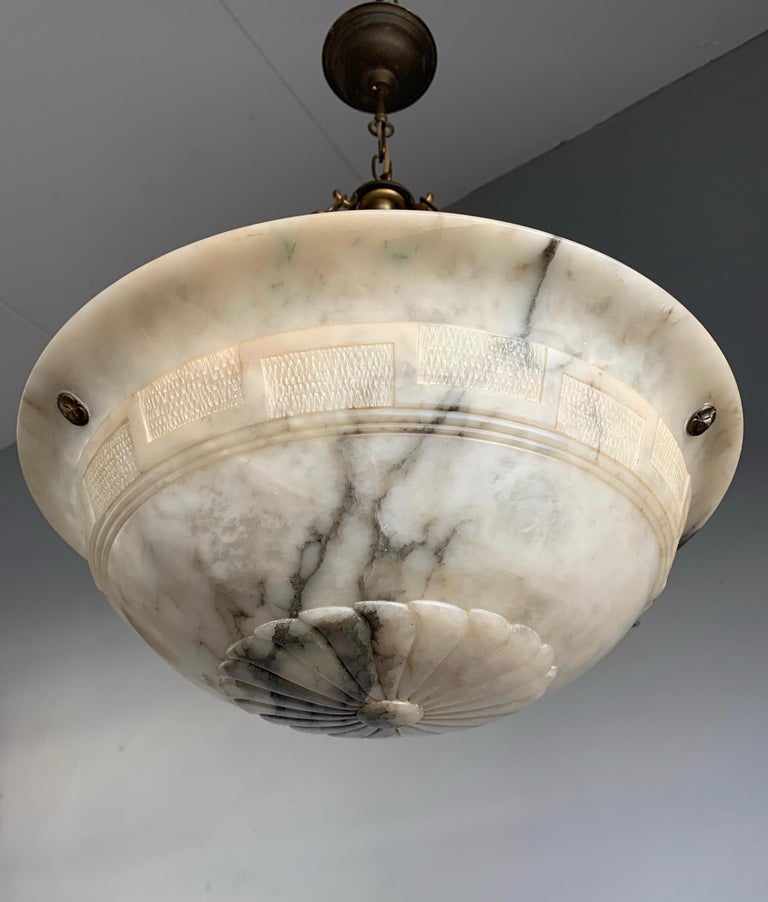 Superb condition chandelier with a stunning and great size alabaster shade.  Thanks to its large & deep size and remarkable design this alabaster chandelier will light up both your days and evenings. It is in excellent condition from top to bottom