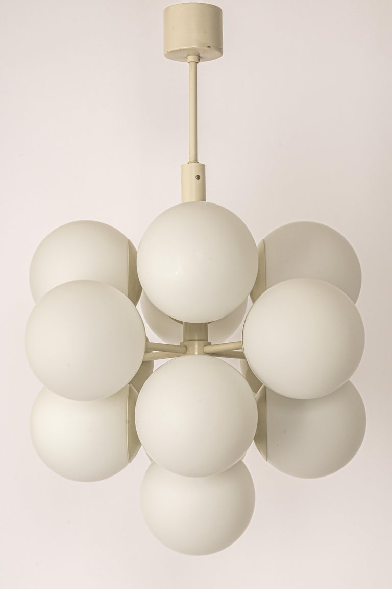 Stunning Sputnik chandelier with 13 handmade glass globes by Kaiser Leuchten, Germany, 1960s.  High quality and in very good condition. Cleaned, well-wired and ready to use.   The fixture requires 13 x E14 small bulbs with 40W max each and