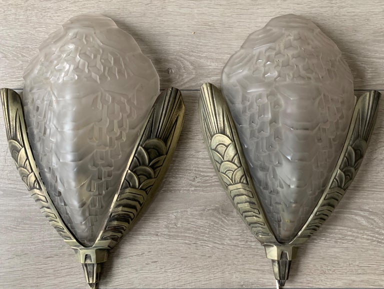 Impressive pair of bronze wall lights with perfect glass shades.  If you are looking for a pair of beautiful and good quality Art Deco wall sconces then these striking lights should be on your shortlist. Both in design and execution these Art Deco