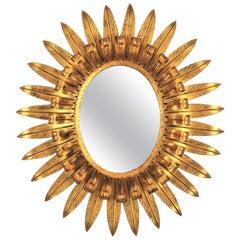 Large Sunburst Eyelash Oval Mirror in Gilt Iron