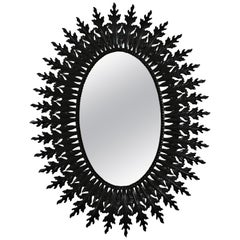 Large Sunburst Oval Mirror in Black Lacquered Iron