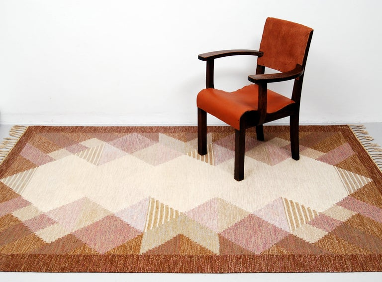 """This rölakan carpet / kelim rug """"Aniara"""" was designed by Anna Johanna Ångström during the 1960s. This example with fields in different shades of brown, purple, beige and grey was woven in wool and signed """"Å"""" to the right hand corner. Original"""
