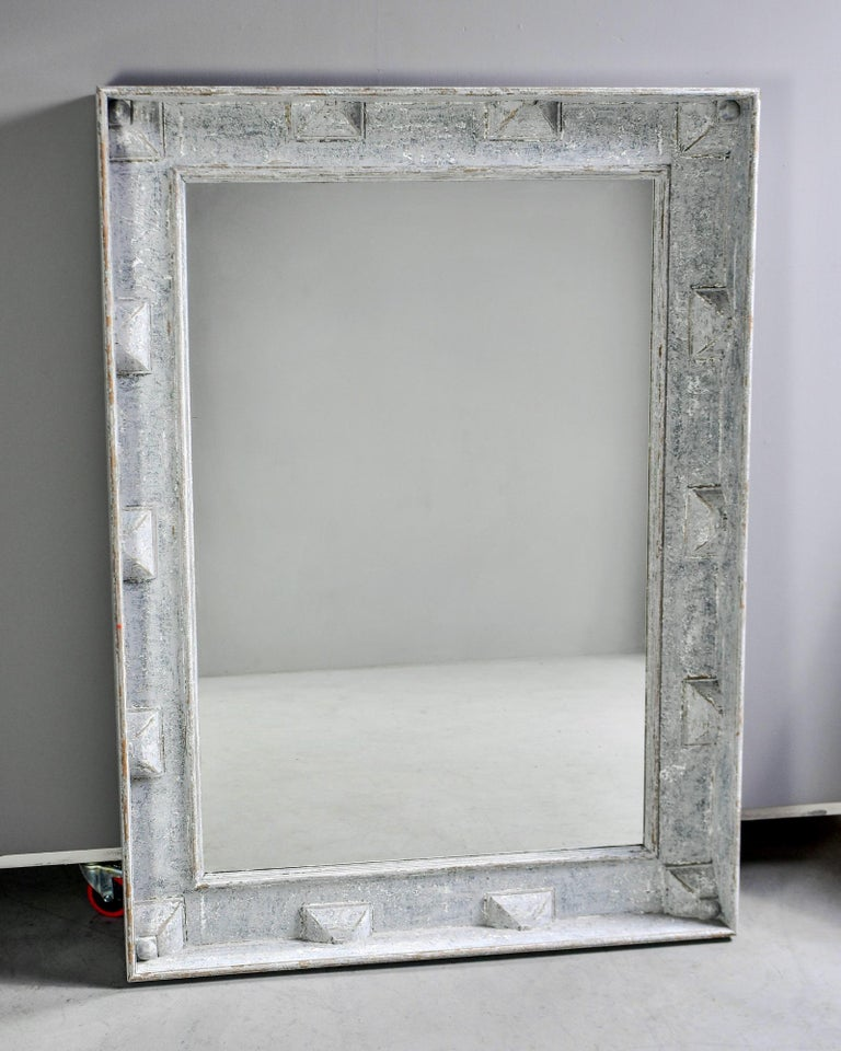 "Large Swedish style mirror measures over five feet tall, circa 2010. Wide wooden frame has a decorative border of raised, pyramid-like forms and a gray-blue painted finish. Actual mirror is 51.75"" high x 35"" wide. Unknown maker."