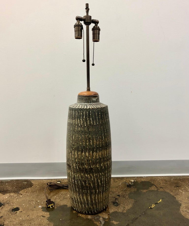 Large vase , now a table lamp by Gunnar Nylund for Rostrand, Sweden , Circa 1960. Signed and marked by manufacturer. Newly rewired. Stoneware base dimensions 21