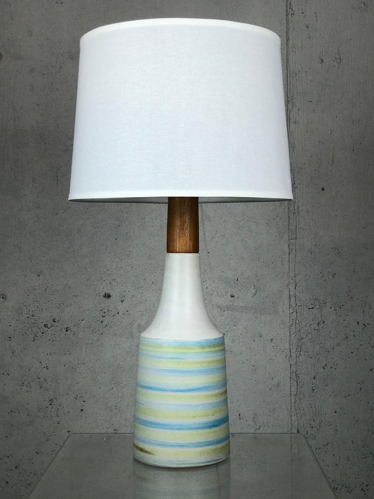 Impressive large Martz walnut and stoneware lamp with wisps of blue and green against a matte grey glaze.