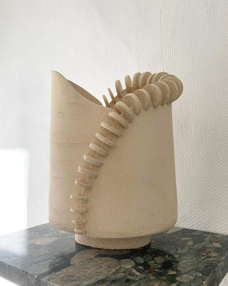 Large Tempo sculpture by Olivia Cognet Materials: Ceramic Dimensions: around 55 cm tall  Tempo Dynamic sculptures decorated with textured, subtly imperfect disks, in which repetition echoes the art of embroidery.  Each of Olivia's handmade