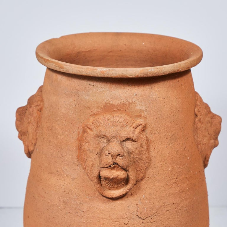 Large terracotta garden pot with lion engraving from early 20th century, England.
