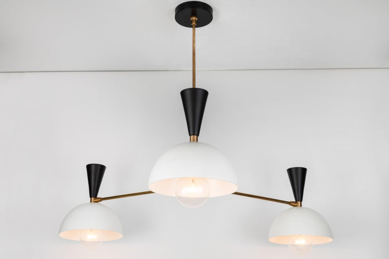 Large three-cone 'Lola II' chandelier in black and white. Hand-fabricated by Los Angeles based designer and lighting professional Alvaro Benitez, this highly refined chandelier is reminiscent of the iconic midcentury Italian designs of Arteluce and