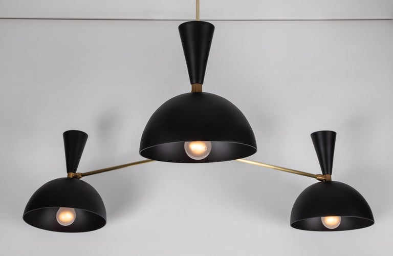 Large three-cone 'Lola II' chandelier in black. Hand-fabricated by Los Angeles based designer and lighting professional Alvaro Benitez, this highly refined chandelier is reminiscent of the iconic midcentury Italian designs of Arteluce and Stilnovo.