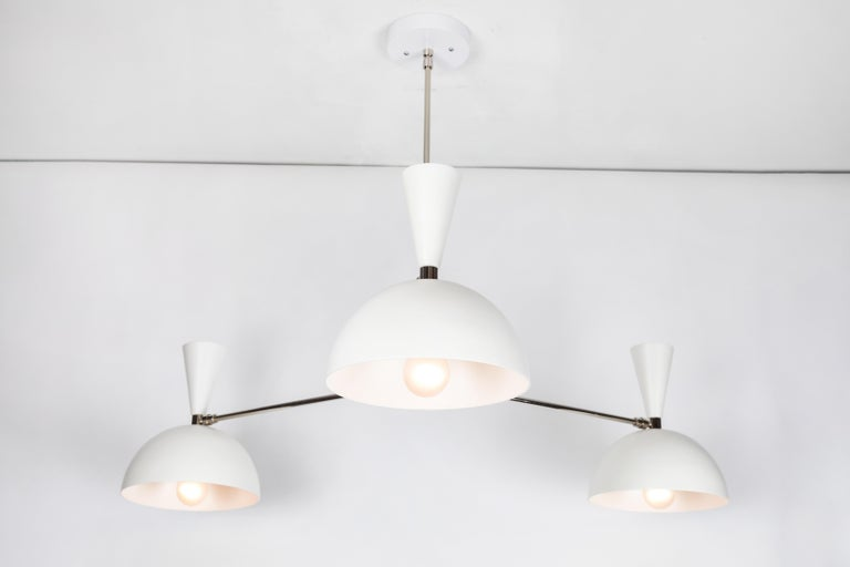 Large three-cone 'Lola II' chandelier in white and chrome. Hand-fabricated by Los Angeles based designer and lighting professional Alvaro Benitez, this highly refined chandelier is reminiscent of the iconic midcentury Italian designs of Arteluce and