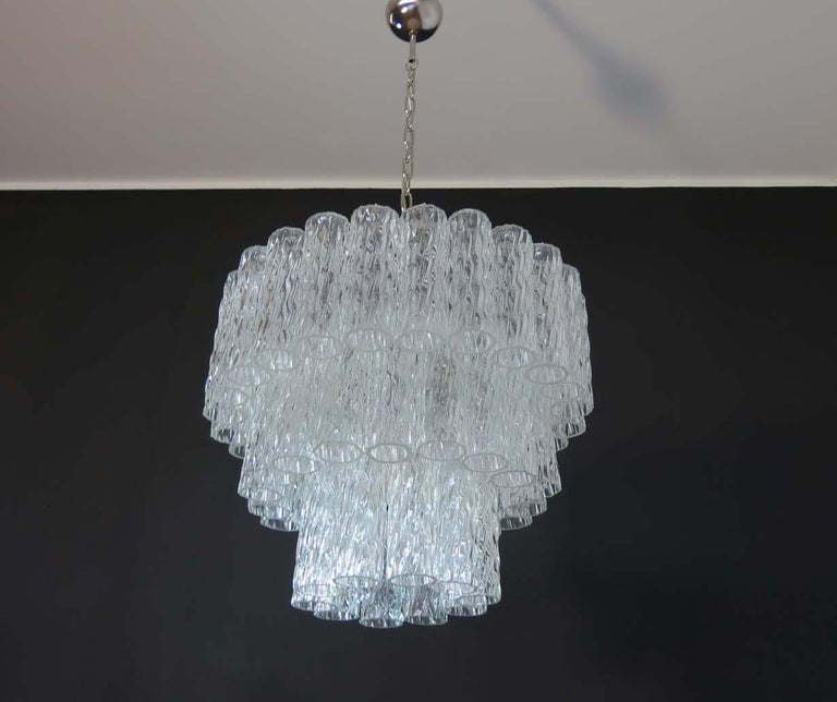 Italian vintage chandelier in Murano glass and nickel-plated metal structure. The polisched nikel armature supports 52 large clear glass tubes which have a slightly textured effect to create an impressive