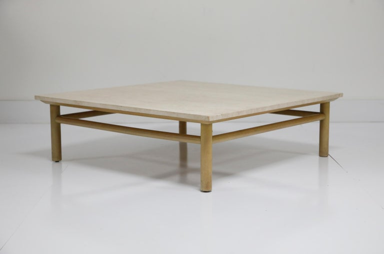 A beautiful, and large, travertine coffee table by T.H. Robsjohn Gibbings for Widdicomb of Grand Rapids. This incredible table is signed on the table base with a Widdicomb placard, and has its original travertine top which is in very good condition.
